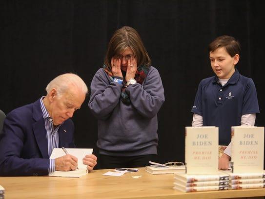 Former Vice President Joe Biden autographs Christina