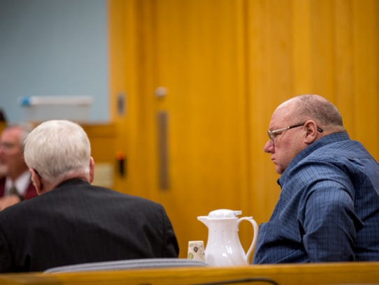 Scott Sawyer listens to testimony during his reckless