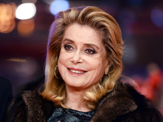 French actress Catherine Deneuve poses on the red carpet