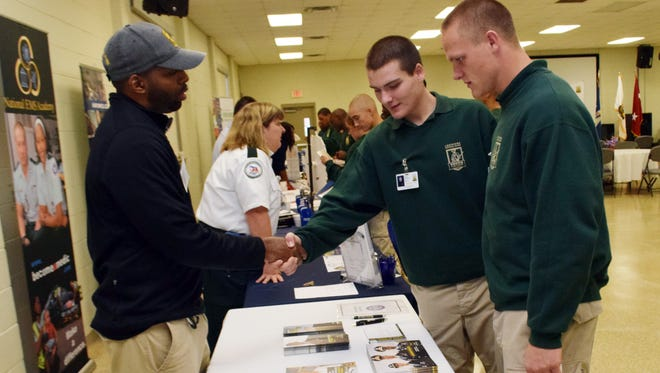 Raymond McDowell (left), recruiting operations officer for the U.S. Army ROTC at Northwestern State University, talks with Youth Challenge Program cadets Nick Conti (center) and Justin Oliver at a job fair held Tuesday by the National Guard Youth Foundation, the National Black Chamber of Commerce and the Louisiana National Guard Youth Challenge Program at Camp Beauregard. More than 25 job recruiters talked with about 80 cadets about employment.