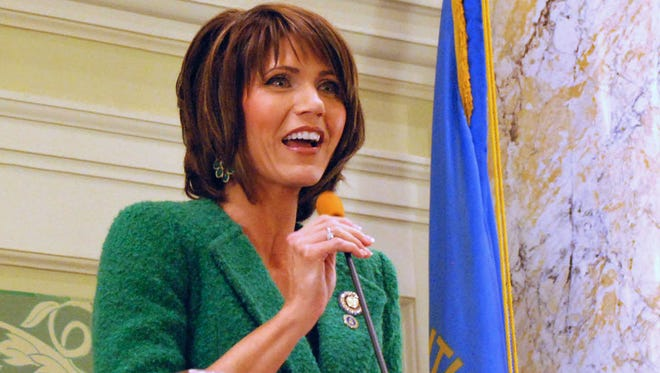 In this Jan. 22, 2014 file photo, U.S. Rep. Kristi Noem, R-S.D., speaks in Pierre to the South Dakota Senate. There is no such thing as a man's work and a woman's work on South Dakota's expansive farms, and that egalitarian mentality is pushing more women than ever to seek top statewide offices. Noem, seeking her third term, faces a woman Democrat for the state's lone Congressional seat.  Noem said it is imperative that women continue to run because leadership should reflect its population. (AP Photo/Chet Brokaw, File) ORG XMIT: CER806