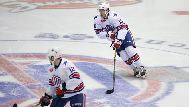 Amerks forward Cole Schneider skates with the puck.