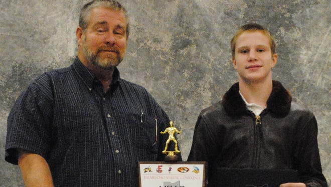 River Valley wrestling coach Mark McGuire, left, stands with RV's state qualifier Jonathan Edwards in this 2011 file photo. McGuire was recently received the OHSAA Ethics and Integrity Award at this year's state wrestling tournament.