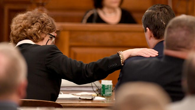 Jennifer Thompson, attorney for Zach Adams, puts her hand on his shoulder as State prosecutor Jennifer Nicols gives her closing argument rebuttal during day ten of the Holly Bobo murder trial, Thursday, September 21. Zach Adams is charged with felony first-degree murder, especially aggravated kidnapping, aggravated rape of Holly Bobo.