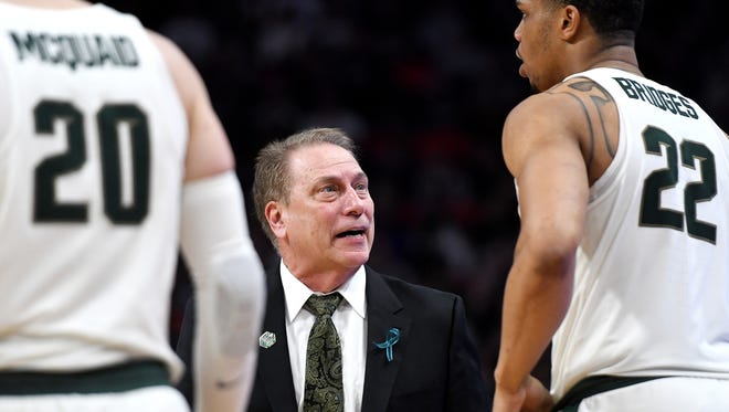 Michigan State's head coach Tom Izzo talks with Miles Bridges, right, during the second half on Sunday, March 18, 2018, at the Little Caesars Arena in Detroit. Syracuse beat Michigan State 55-53.