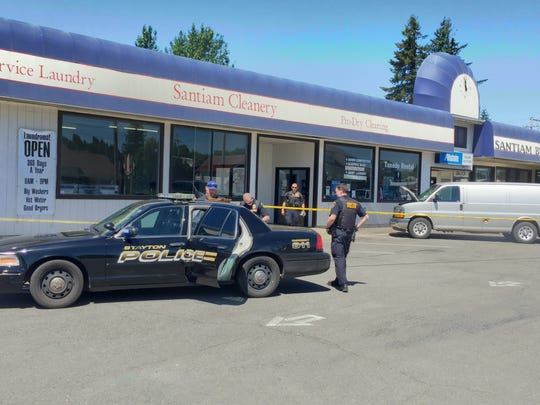 Santiam Cleanery on First Ave. was one of three locations police served warrants Wednesday morning.