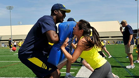 Participants work during drills at the Michigan Women's Football Academy in Ann Arbor in 2012.