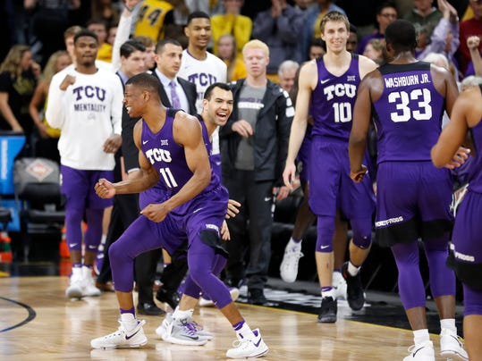 TCU guard Brandon Parrish (11) celebrates with teammate Michael Williams at the end of a second-round game against Iowa in the NIT college basketball tournament, Sunday, March 19, 2017, in Iowa City, Iowa. TCU won 94-92. (AP Photo/Charlie Neibergall)