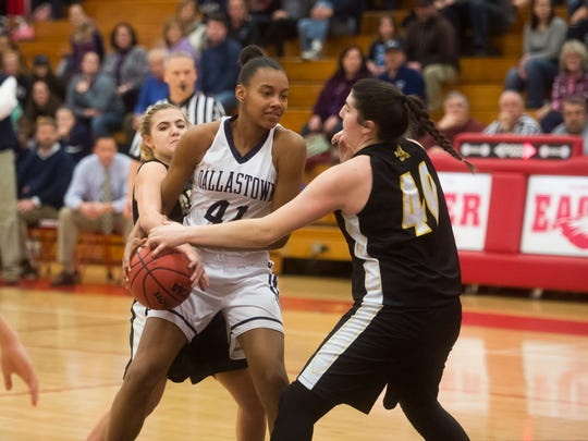 Dallastown's Aniya Matthews is stripped of the ball by Delone Catholic's Bradi Zumbrum (40) and Natalie Wildasin during play on Friday, Feb. 10, 2017. Delone defeated Dallastown 45-44.