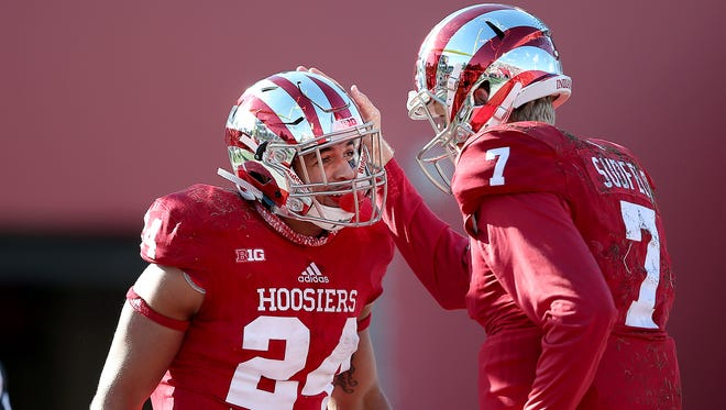 Indiana Hoosiers quarterback Mike Majette (24) celebrates his touchdown against Rutgers with Hoosiers quarterback Nate Sudfeld (7) in the first half of their game at Memorial Stadium.