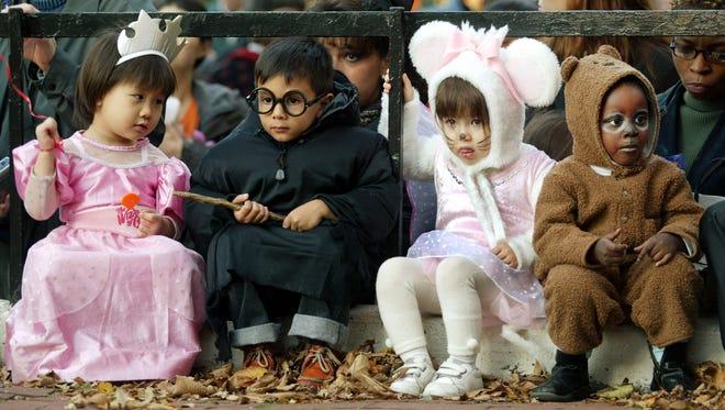Children gather during the annual Children's Village Halloween Parade October 31, 2002, in New York City.