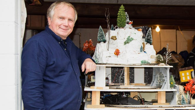 George Lemke poses with his new train layout recently in his home at 866 DeTurksville Road in Pine Grove. The layout was made by St. Mark Lutheran Church volunteers to benefit Operation Santa.