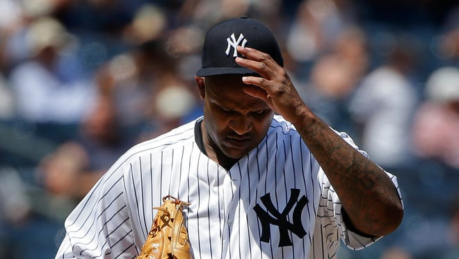 New York Yankees pitcher CC Sabathia adjusts his cap after giving up a base hit to Colorado Rockies' Mark Reynolds during the fourth inning of a baseball game, Wednesday, June 22, 2016, in New York.