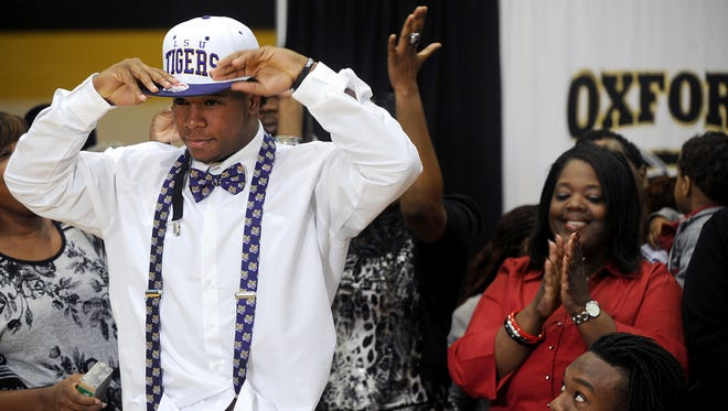 In this 2012, file photo, Oxford High School student Kwon Alexander dons an LSU cap signifying his intent to attend and play football there during a news conference on national signing day.Tamika Moore/AL.com via AP, File)