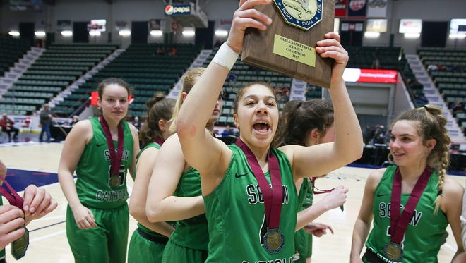 Seton Catholic's Lexi Levy celebrates Sunday after winning the girls Class B final of the Federation Tournament of Champions at the Glens Falls Civic Center.
