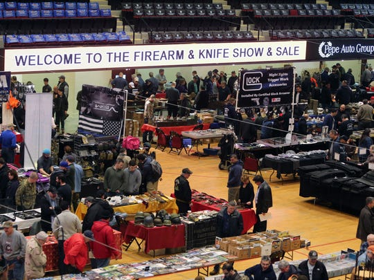 Attendees mill about at the Firearm and Knife show