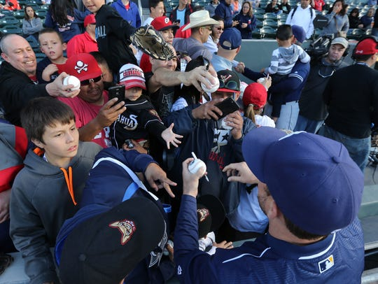 Fans seek autographs from San Diego players before