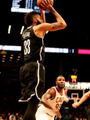 Brooklyn Nets' Allen Crabbe (33) shoots a three point basket over Cleveland Cavaliers' Jae Crowder (99) during the second half of an NBA basketball game Wednesday, Oct. 25, 2017, in New York. The Nets won 112-107. (AP Photo/Frank Franklin II)