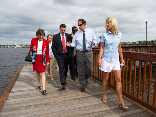 Sen. Joe Negron (second from right) gives Florida House