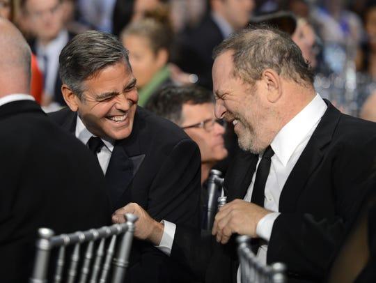 George Clooney and Harvey Weinstein in 2013.
