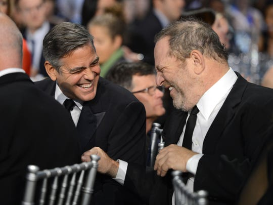George Clooney and Harvey Weinstein in 2013.