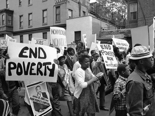 """A segment of the """"poor peoples"""" march on Washington moves through a north Philadelphia street on May 14, 1968 enroute to a rally at Independence Hall which marked the march''s progress to the capitol."""