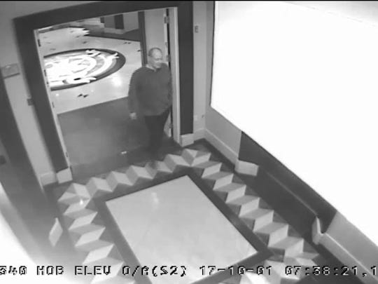In this Oct. 1, 2017, security camera image released by MGM Resorts, is Stephen Paddock walking through the Mandalay Bay hotel in Las Vegas. Newly released video shows Paddock, who killed 58 people on the Las Vegas Strip, moving around a casino before the attack, gambling, bringing suitcases into his room at Mandalay Bay but doing nothing that would obviously raise suspicions.