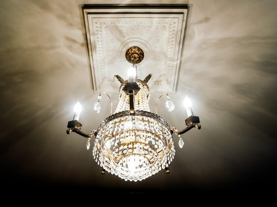 The house at 1716 North Parkway, which was built in 1906 has several chandeliers that once lived in the downtown Peabody Hotel.
