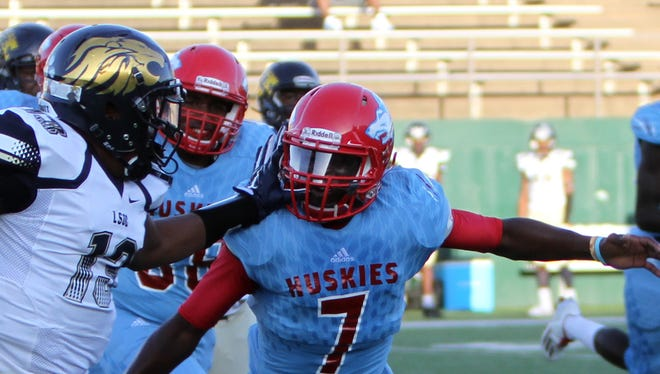 Hirschi's Isaiah White (7) has been a stalwart at linebacker for the Huskies, leading them in tackles. His path to joining the program is filled with tragedy and love.