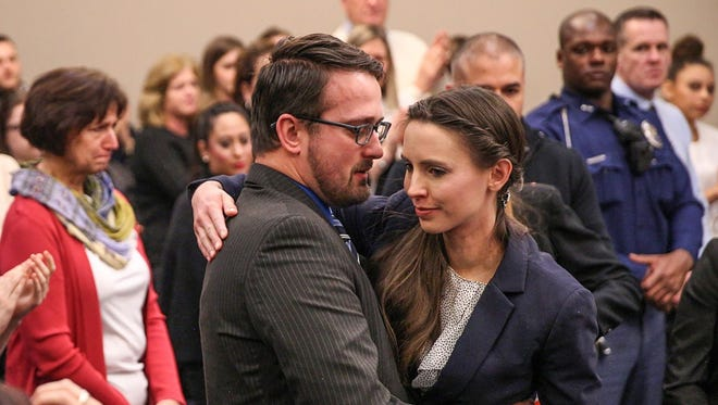 After delivering her impact statement Jan. 24, 2018, in front of former USA Gymnastics doctor Larry Nassar, Rachael Denhollander is hugged by her husband, Jacob, inside Ingham County Circuit Court in Lansing, Mich.