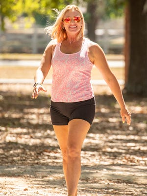 Marlo Alleva shows walking is a good way to exercise.