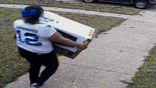 This woman is suspected of stealing packages off of strangers' front door steps in Dallas.