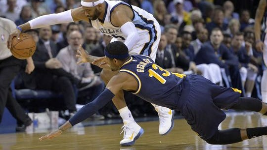 Memphis Grizzlies guard Vince Carter, top, and Indiana Pacers forward Paul George (13) reach for the ball during the second half, April 15, 2015, in Memphis, Tenn.