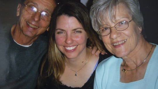 A 2011 photo of Armand (left) and Kathy Young (right) with their daughter, Jennifer Young.