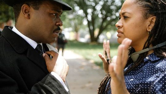 """David Oyelowo (as Dr. Martin Luther King Jr.) discusses a scene with director/executive producer Ava DuVernay on the set of the motion picture """"Selma."""""""