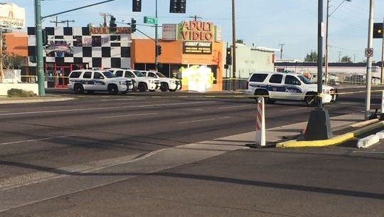 Phoenix police responded to an officer-involved shooting near 16th and Van Buren street on March 11, 2015.
