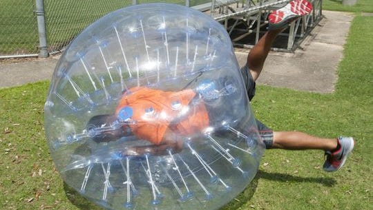 EJ Pakingan demonstrates the unique feature of Bubble Soccer during a demonstration of the new sport at Roger Scott Athletic Complex Thursday morning.