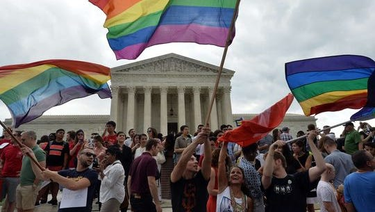 People celebrate outside the Supreme Court on June 26, 2015, after the same-sex marriage decision.