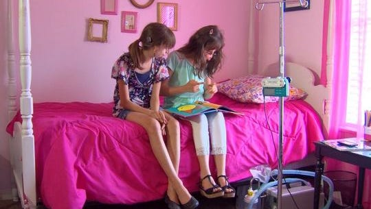 Two girls born with the same facial deformity worlds away from each other, are now sisters and best friends.
