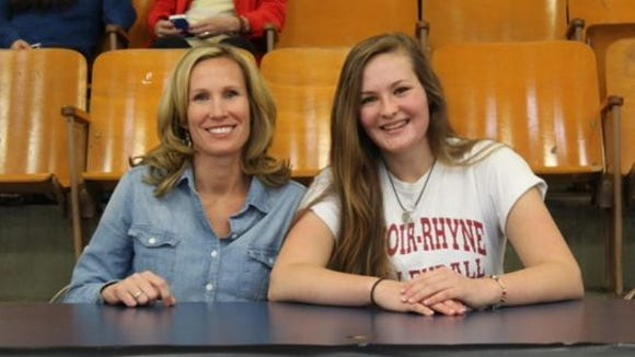 Jen Peterson, left, was present for Roberson graduate Kathryn Sizemore's signing with Lenoir-Rhyne in 2014.