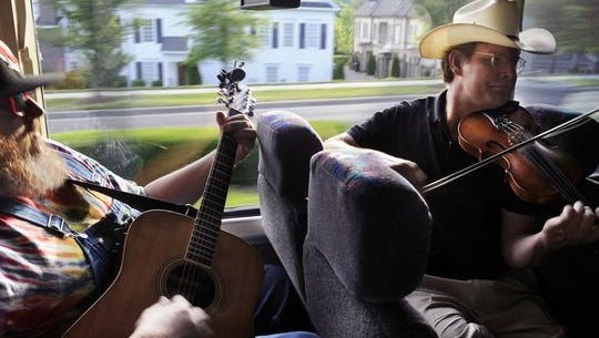Travis Stinson, left, and Johnny Campbell of the band the Bluegrass Drifters perform on a bus from Nashville to the Music City Roots in Franklin. Franklin has been marketed as a destination for Americana lovers.