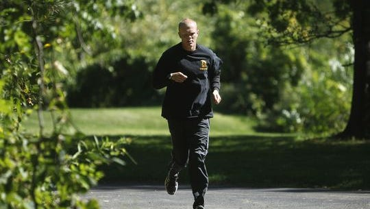 Jason McElwain trains for his first marathon, the Rochester Marathon, in 2012 in New York.