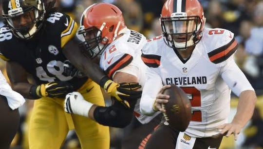 Cleveland Browns quarterback Johnny Manziel scrambles away from Pittsburgh Steelers linebacker Bud Dupree earlier this month. Manziel isn't expected to play Monday night against the Baltimore Ravens.