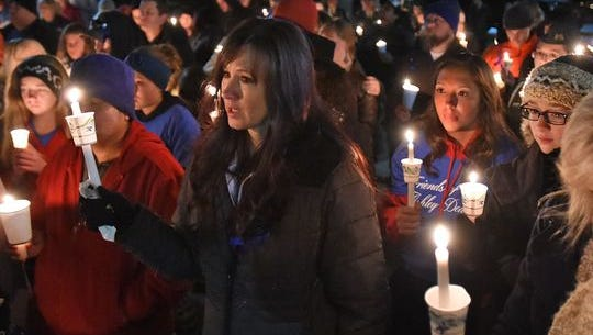 The Reno community gathered for a candlelight vigil on Sunday night to remember the two children killed in a home shooting in Reno.
