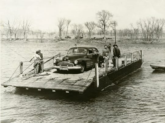 A car is transported across the Mississippi River in the spring of 1952 by the Clearwater ferry.