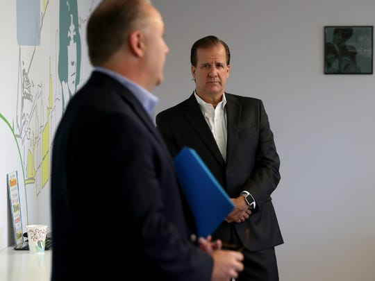 Brian Priester, left, the new president of the Detroit Free Press and Michigan.com talks as Michael G. Kane, East Group president, Gannett Domestic Publishing looks on and listens during the announcement that Priester would become the new president replacing the retiring Joyce Jenereaux.