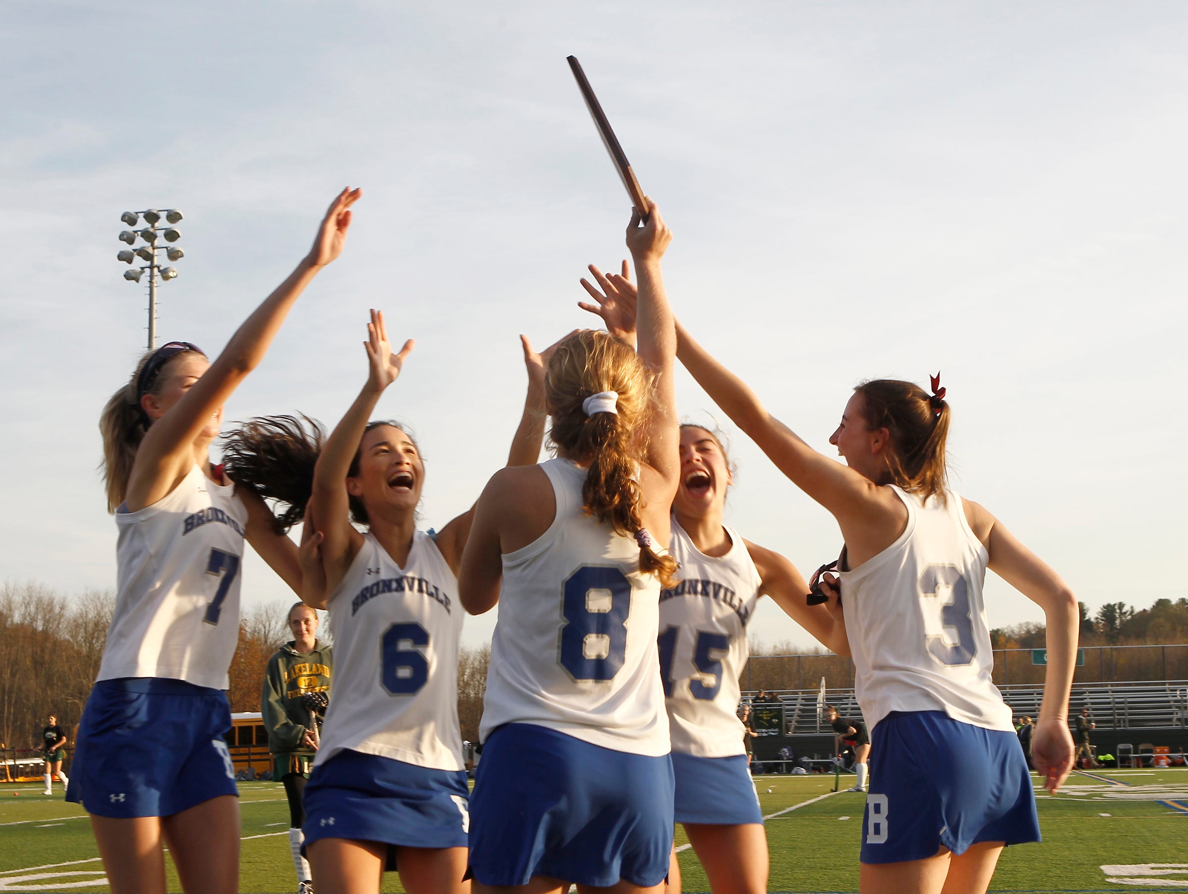 Bronxville's celebrates their 7-1 win over Croton in the Class C field hockey sectiion finals at Brewster High School on Tuesday, November 1, 2016.