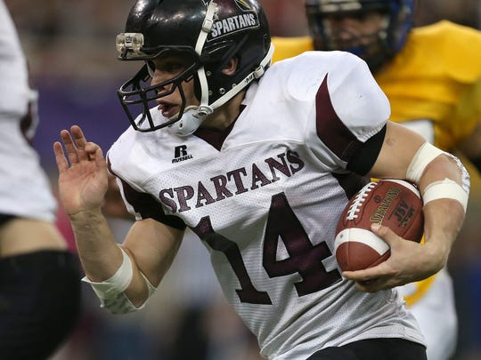 Exira quarterback Drew Peppers carries the ball against Don Bosco during the state football championship game on Thursday, Nov. 21, 2013, at the UNI-Dome in Cedar Falls. (Bryon Houlgrave/The Des Moines Register)