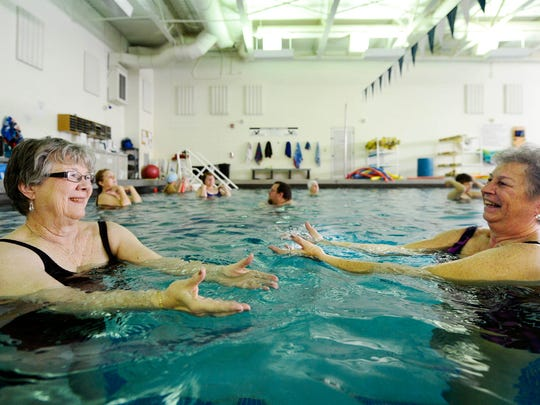 Pat Fromme, left, and Carol Drueckhammer stretch their arms through the water. 'It keeps my joints moving,' said Drueckhammer. 'That's the most important thing.'