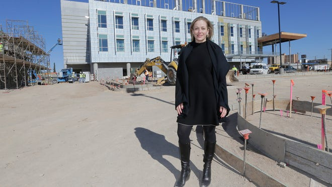 Emma Schwartz, president of the Medical Center of the Americas Foundation, announced the start of an innovation challenge with the Center for Advancing Innovation, based in the Washington, D. C., area. She is standing in front of the MCA's biomedical research and technology facility under construction in Central El Paso.
